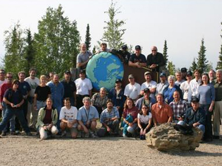 Coordinating Committee meeting participants posed for photos at the Arctic Circle. Photo courtesy of: Nancy Grimm.