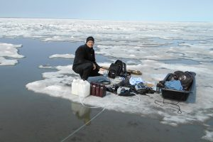researcher and equipment on floating ice