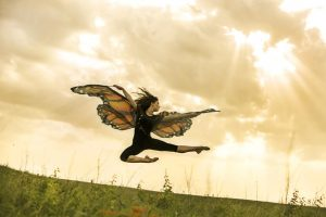 Winged dancer leaps over a field of milkweed