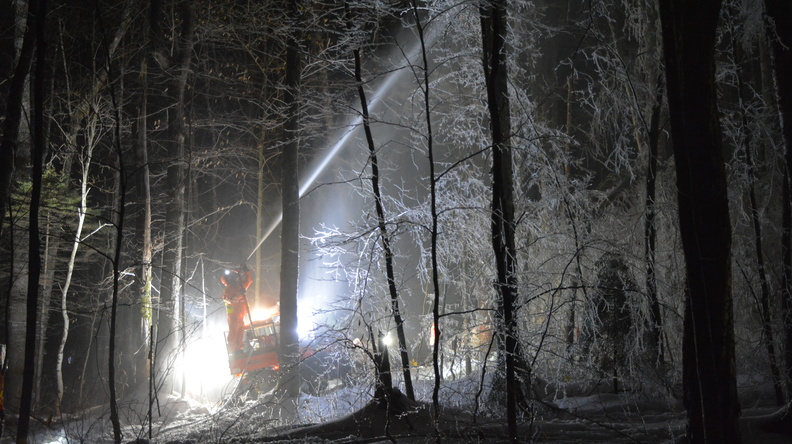 fire hose coating Hubbard Brook forest with ice at night