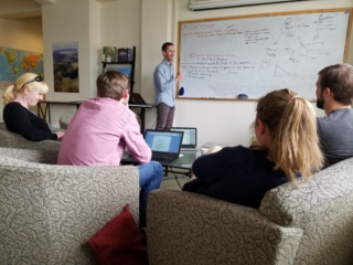 group attending intensely to diagrams on whiteboard