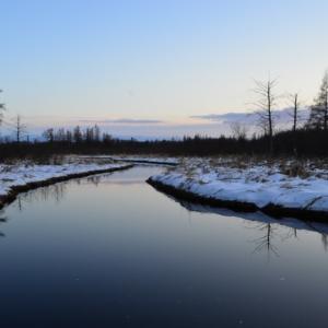 long view down a snowy river