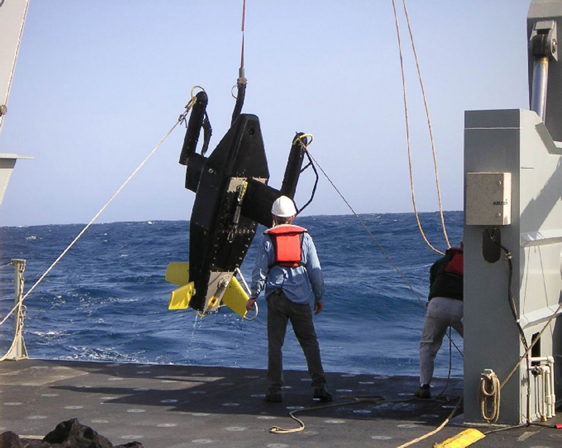 hauling a large instrument aboard ship