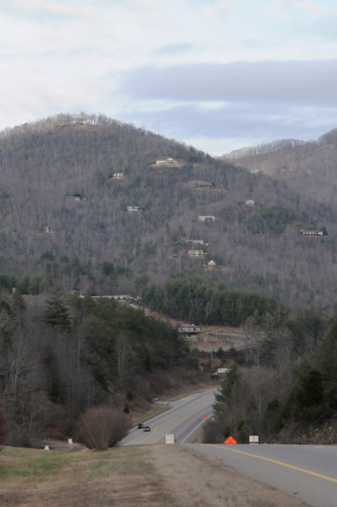 A view from the highway looks out over rural homes that speckle the foothills of Appalachia in the winter