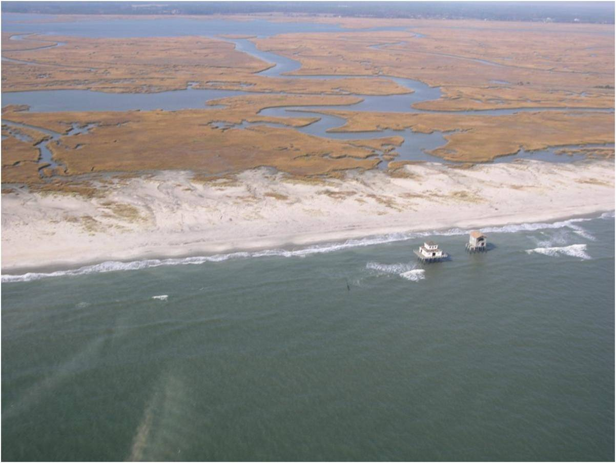 Barrier island with houses out in the water