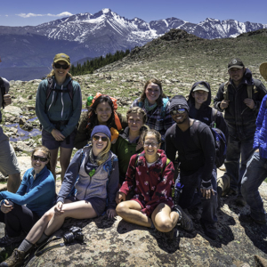 group of studnets with mountains in background