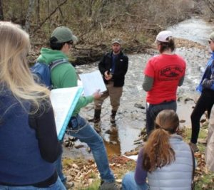 Jason Meador of the Land Trust for the Little Tennessee talks to ICON students in Cat Creek.