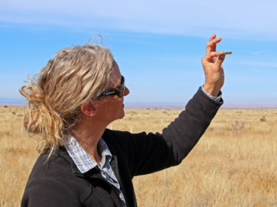 Dr. Rudgers examines a sample of soil crust.