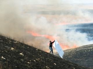 Erin Wiersma imprinting charred biomass.