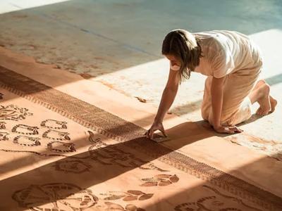 Tallgrass Artist Resident Rena Detrixhe working on her installation at Konza Prairie Station, 2017.